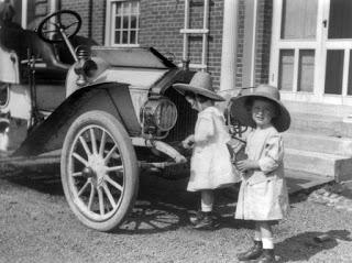 Small twin girls in front of 1911 Buick roadster.jpg