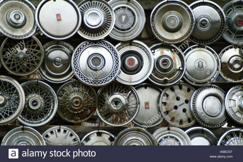 collection-of-vintage-hubcaps-A5BCGT.jpg