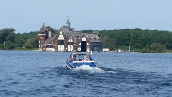 Ron & Val swiming over to the Boldt yacht house.jpg
