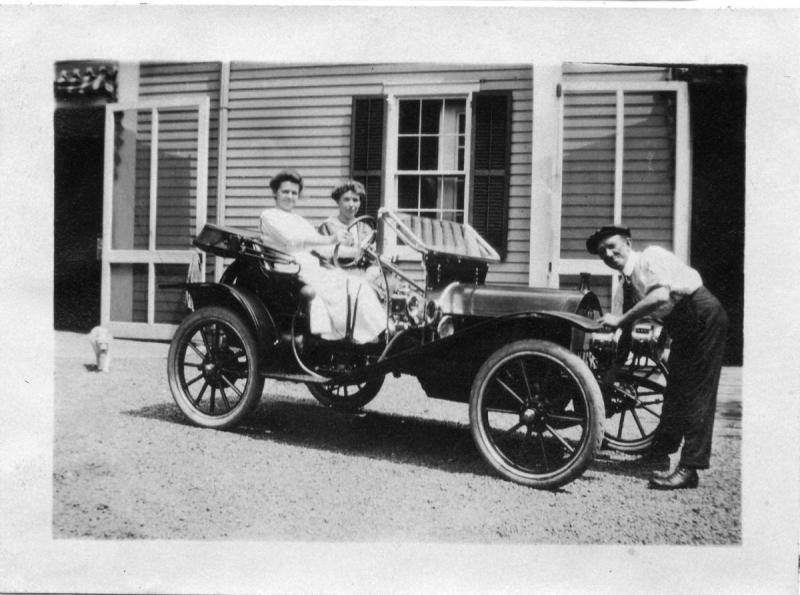 Great grandma Annie at wheel of auto.jpg