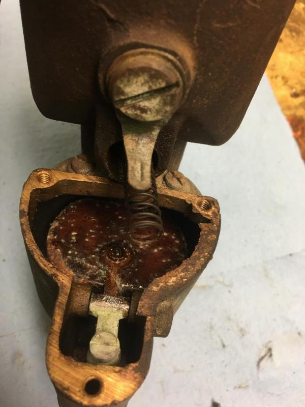 cover removed from fuel bowl of carb.  Cork float in view.jpg