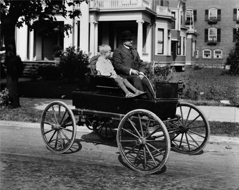 r-hopkins-on-horseless-carriage-seattle-1916.jpg