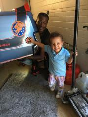 "My grandson ""Haze"" and I workin on the Buick."