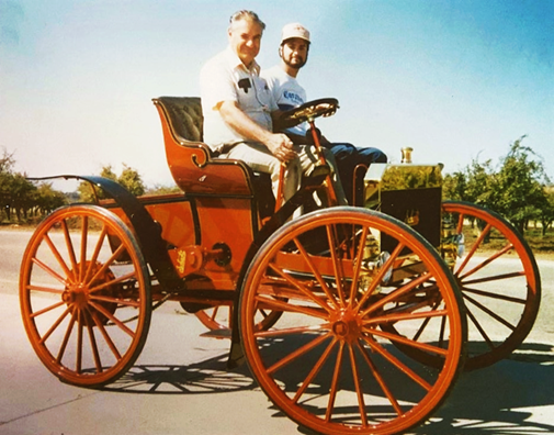 Francis Tarzian in the 1907 Schacht he restored, with his son Nathan, circa 1987.png