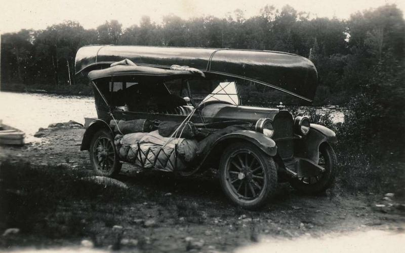 Touring car with boat on roof.jpg