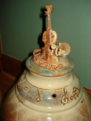 Close up of Violin & Trumpet Jar