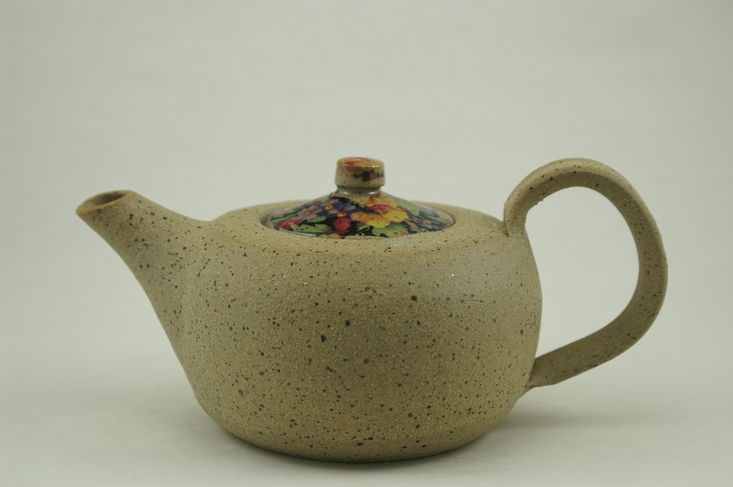 Teapot ^6, liner glaze, vintage decals on lid.