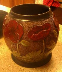 hand carved poppy vase glazed