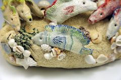 Colored Porcelain fish & found objects