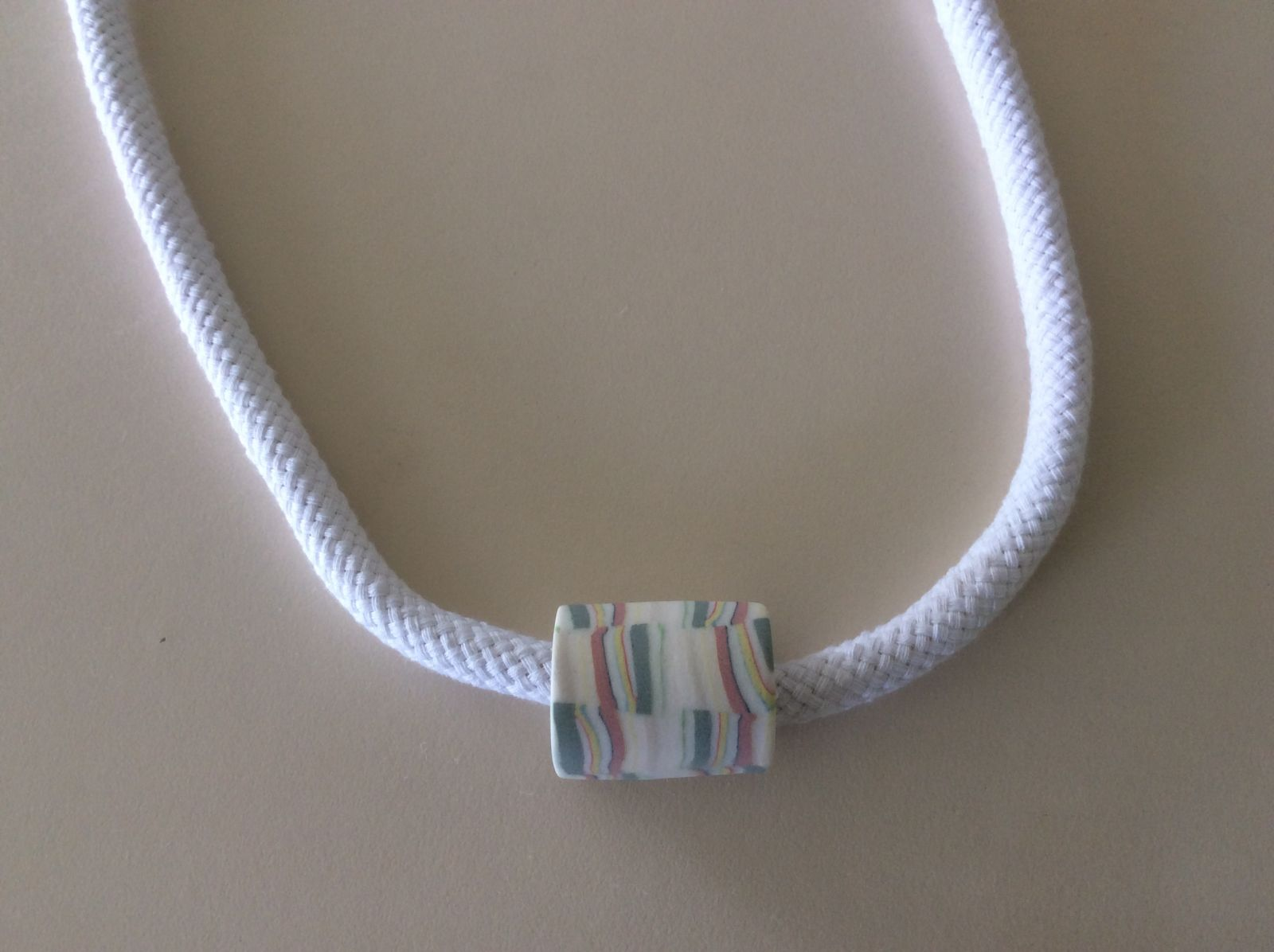 Coloured polished porcelain on rope cotton neck pie e