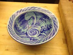 Bowl with clear glaze with copper carbonate and cobalt blue wax resist design