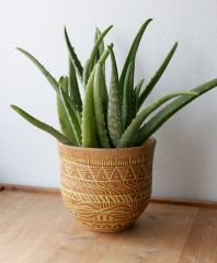 Stoneware planter with yellow mishima wax resist decoration