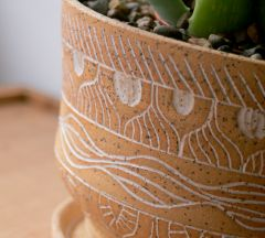 Detail, stoneware planter with white mishima wax resist decoration