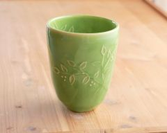 Green tumbler in green with slip trailed leaves and branches (and a peekaboo design inside too)
