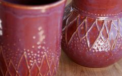slip trailing detail on mug and tumbler