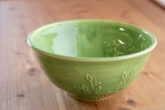 Slip trailed bowl in green