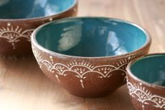 Cereal bowl in teal and brown with slip trailed decoration