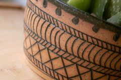Detail, stoneware planter with mishima wax resist decoration