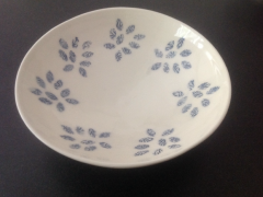 Shallow dish with tissue transfer motifs