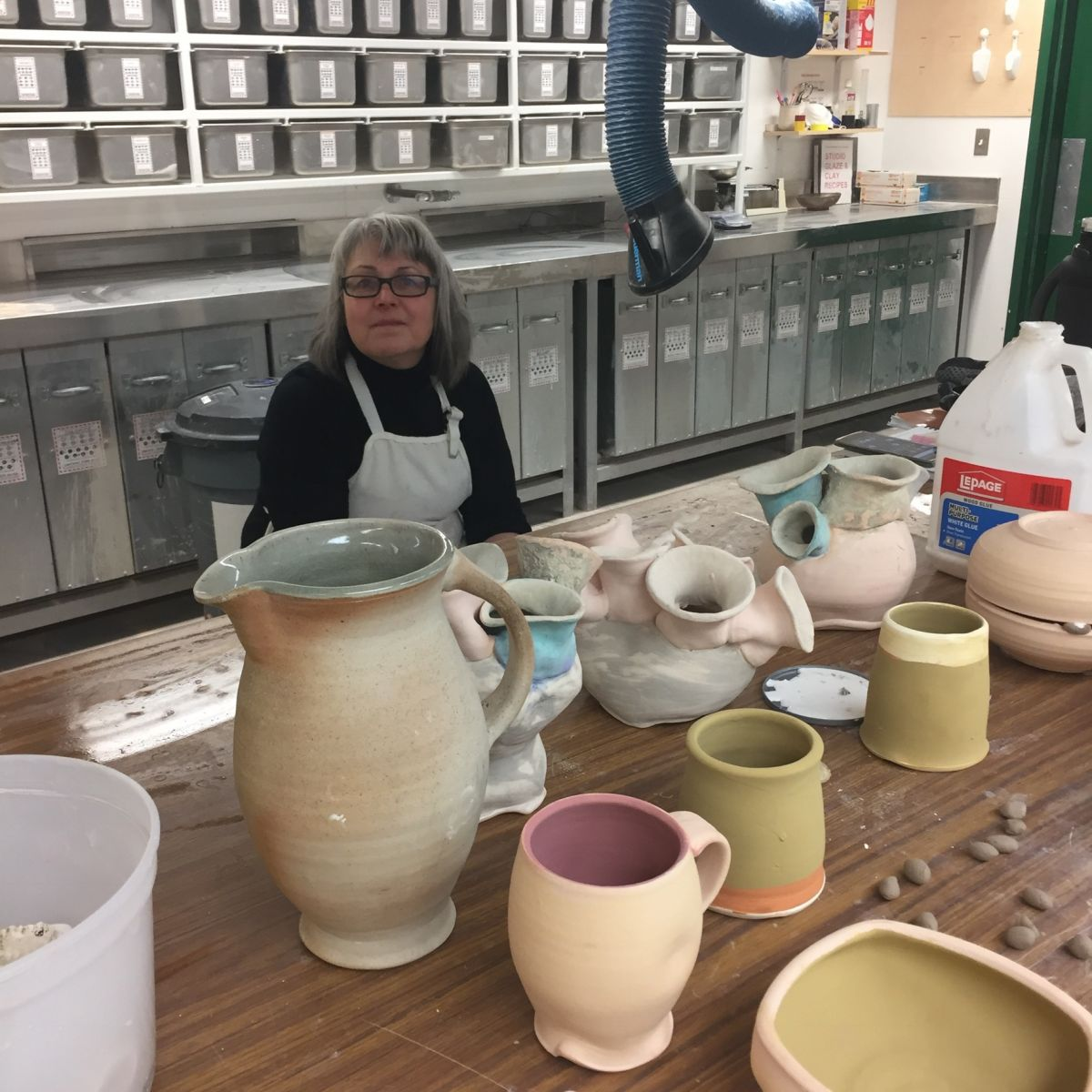 The lovely Terri in the glaze room as we wadded pots last night.
