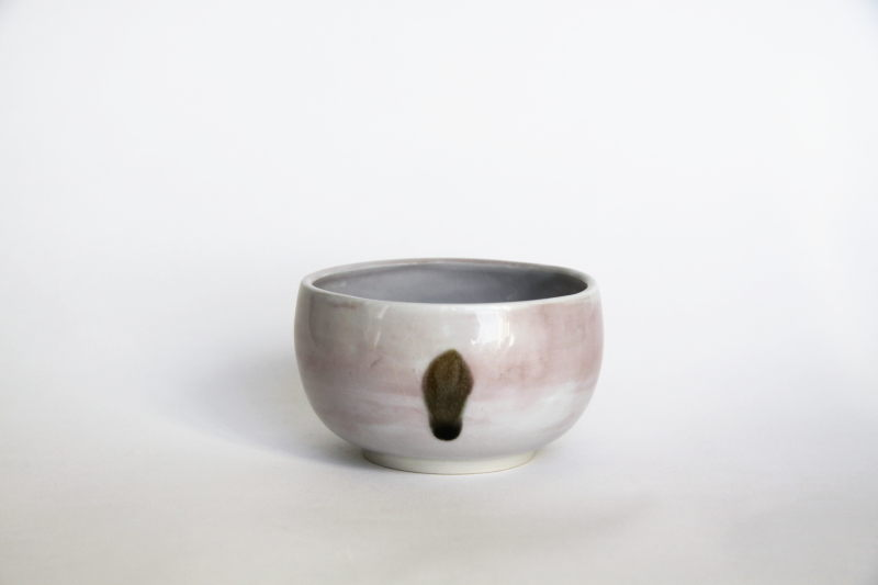 Small porcelain bowl with a dot