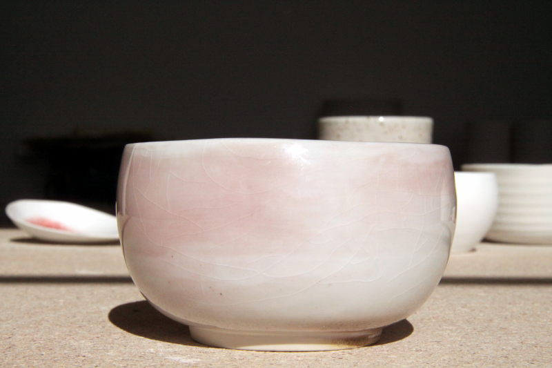 Small porcelain cup with pink hue