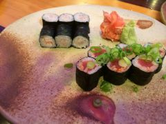Woodfired plate detail with sushi rolls