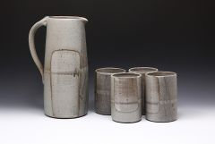Tall pitcher with four tumblers
