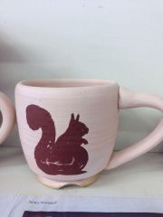 Squirrel wax resist mug unfired