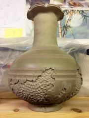 Vase. Altered and carved.