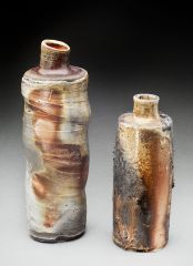 two ashy bottles, fired on their sides