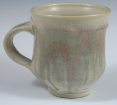 Mug with green slip and blue ash