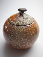 soda-fired round lidded orb-jar with river rock