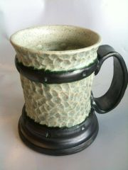 Thrown and carved beer stein or tankard