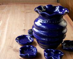 Cobalt Ripple Vase with assorted little flower spoon rests all around.
