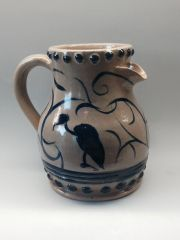 Staggered spout brushwork pitcher
