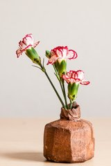 Faceted vase, red clay with thin brownish glaze