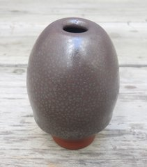 Spotty glaze on red earthenware