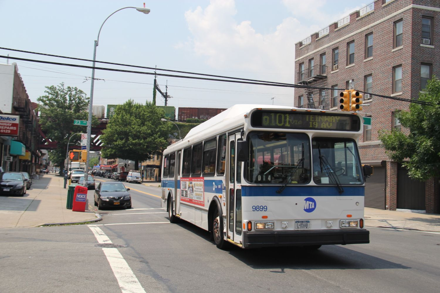 1999 Orion V CNG #9899 Q101 at Steinway Street and 23rd Avenue