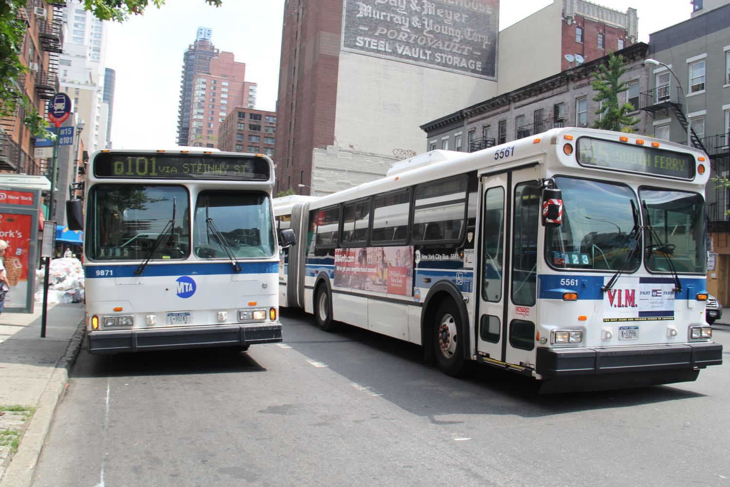 1999 Orion V CNG #9871 Q101 and 2003 D60HF #5561 M15 at 2nd Avenue and 61st Street