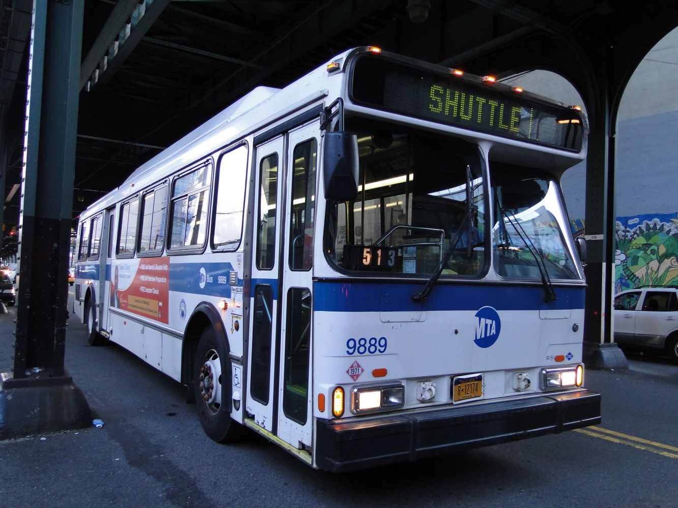 1999 Orion V CNG #9889 (N) Subway Shuttle at 31st Street and Ditmars Blvd