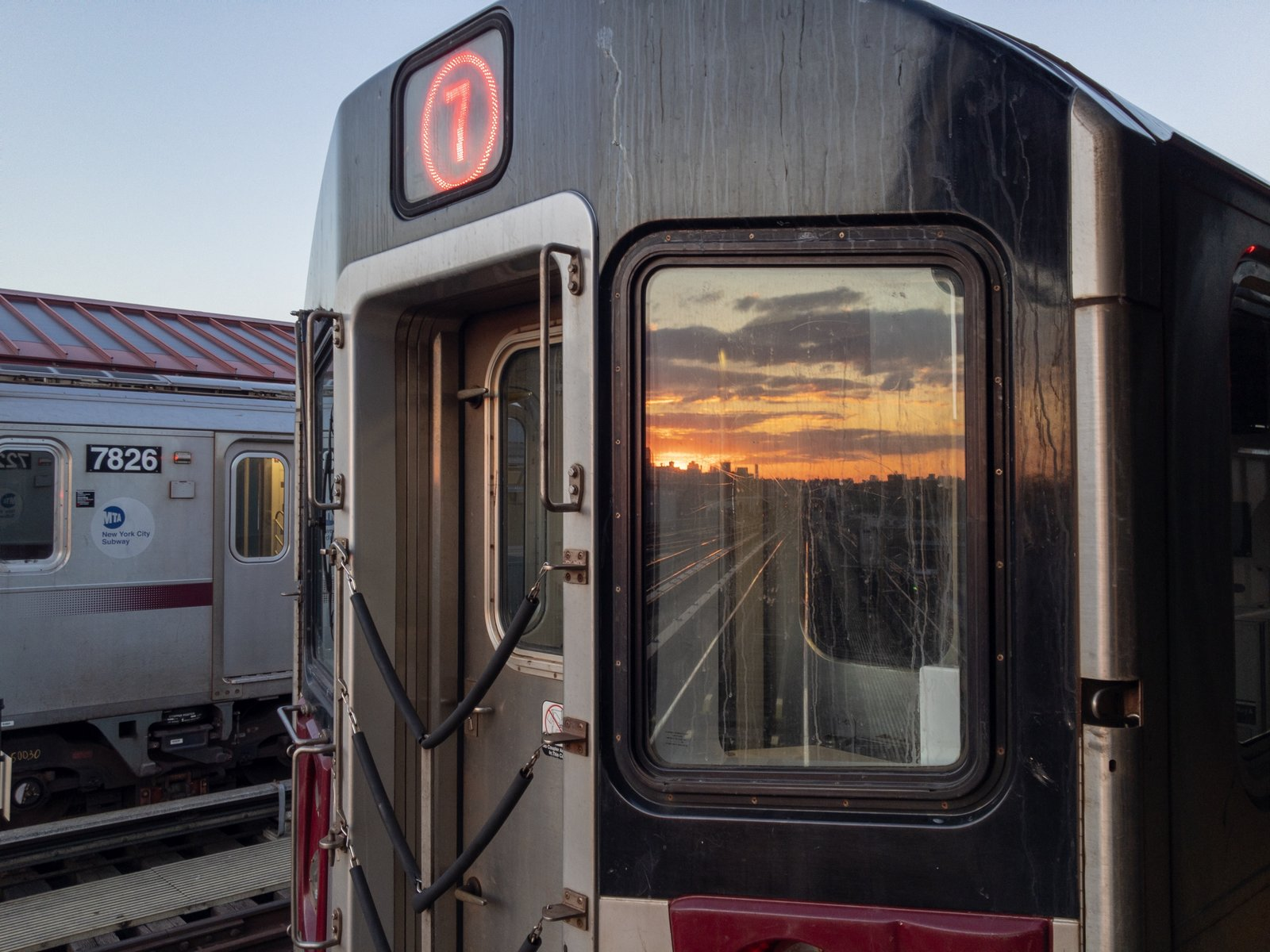 A 7 train reflecting the sunset