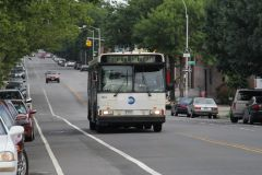 1996 Orion V #164 Q100 at 20th Avenue and 28th Street