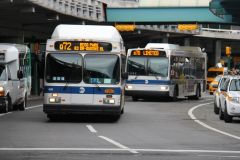 2012 C40LF CNG #639 Q72 and 2009 Orion VII NG HLF #4034 Q70 on Central Terminal Drive at Central Terminal B in LaGuardia Airport