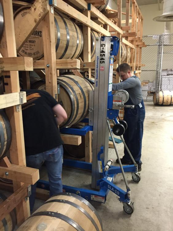 Loading a barrel into the rack.jpg