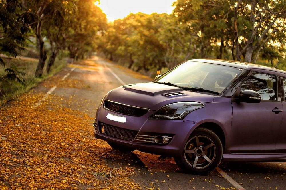 Maruti-Swift-matte-purple-wrap-and-sporty-body-kit-front-three-quarter.jpg