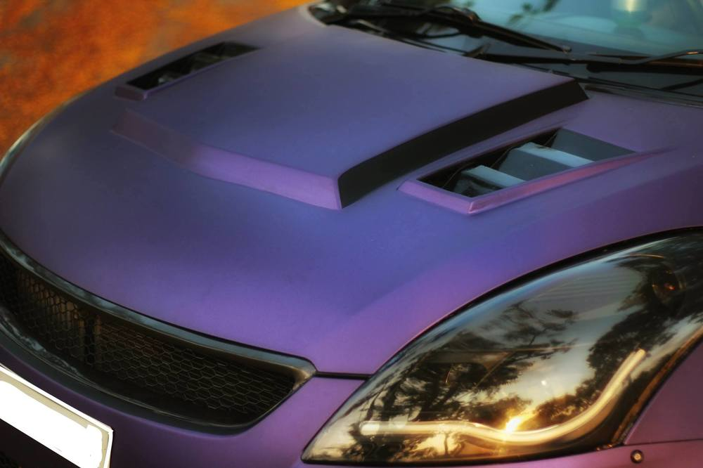 Maruti-Swift-matte-purple-wrap-and-sporty-body-kit-headlamp.jpg