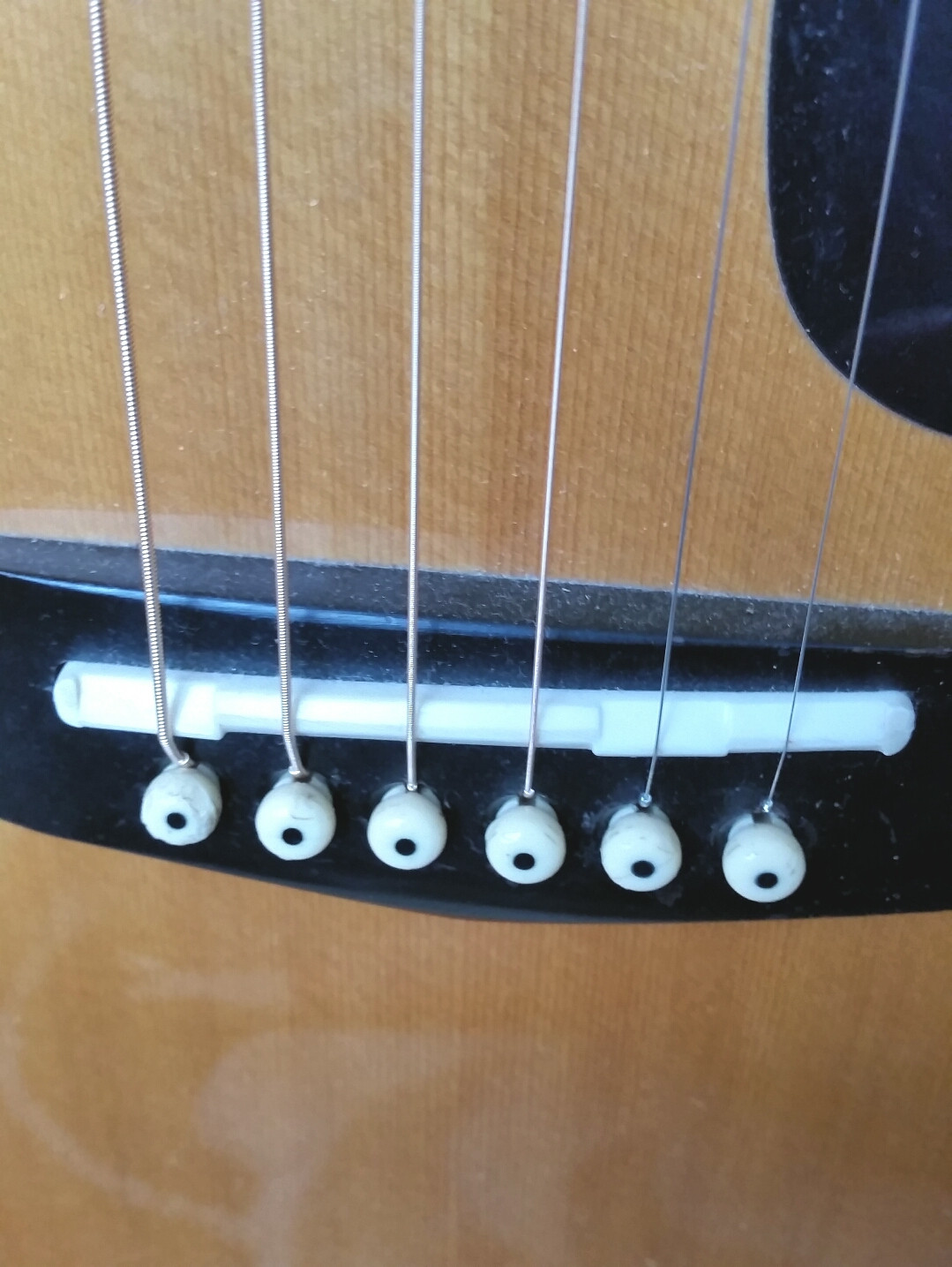 Under Which String Does The Compensated Part Of The Saddle Go Acoustic Guitars Harmony Central